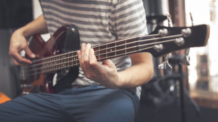 Man Playing Bass Guitar | Bass Guitar for Beginners: A Definitive Guide To Learning