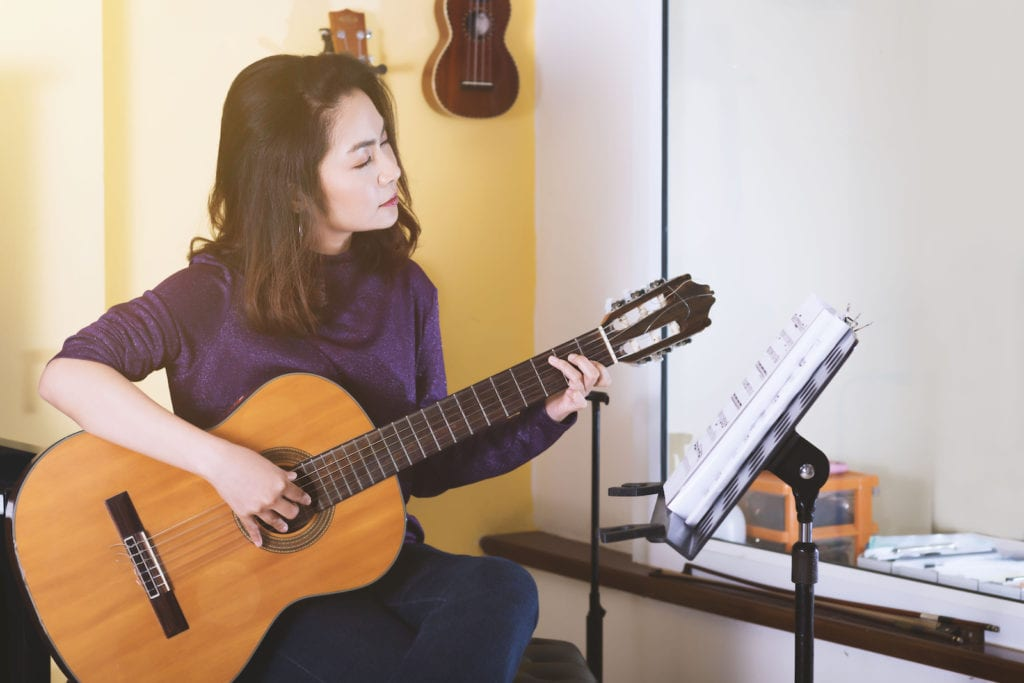 Woman Playing Guitar   Best Way To Learn Guitar at Home (6 Easy Tips)
