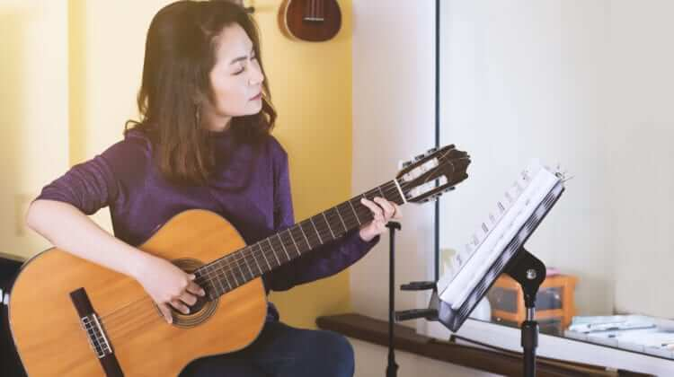 Woman Playing Guitar | The Best Way To Learn Guitar On Your Own (3 Easy Tips)
