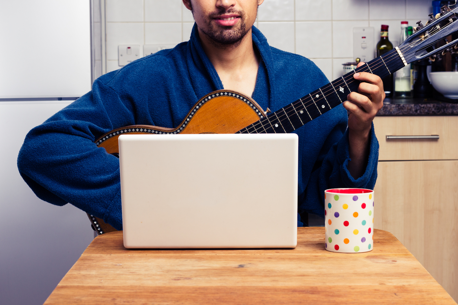 Man Playing Guitar in Front of Laptop | The Best Way To Learn Guitar On Your Own (3 Easy Tips)