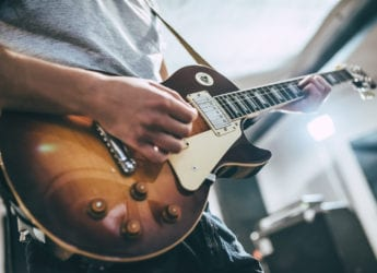 Man Playing Electric Guitar | The Ultimate Guide To Playing Electric Guitar for Beginners