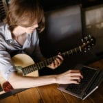 Woman Playing Guitar | Top 3 Sites To Help You Easily Learn To Play Guitar Online