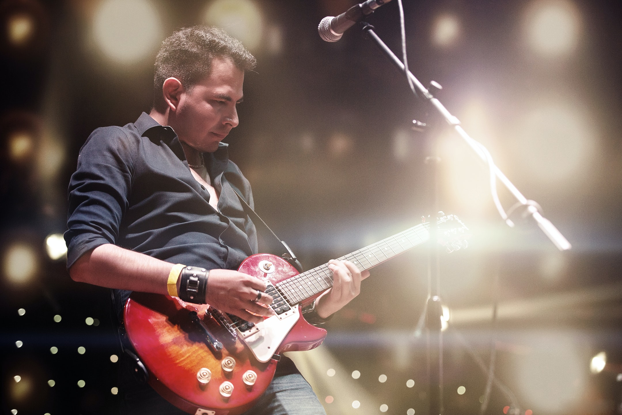 Man Playing Electric Guitar | The Top 15 Guitar Terms You Need To Know