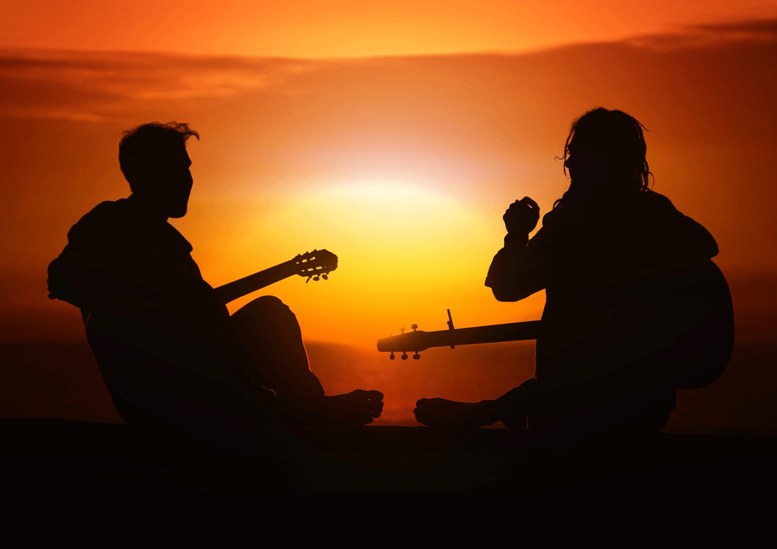 Men Playing Acoustic Guitar Sunset | The Top 6 Techniques For Practicing Acoustic Guitar