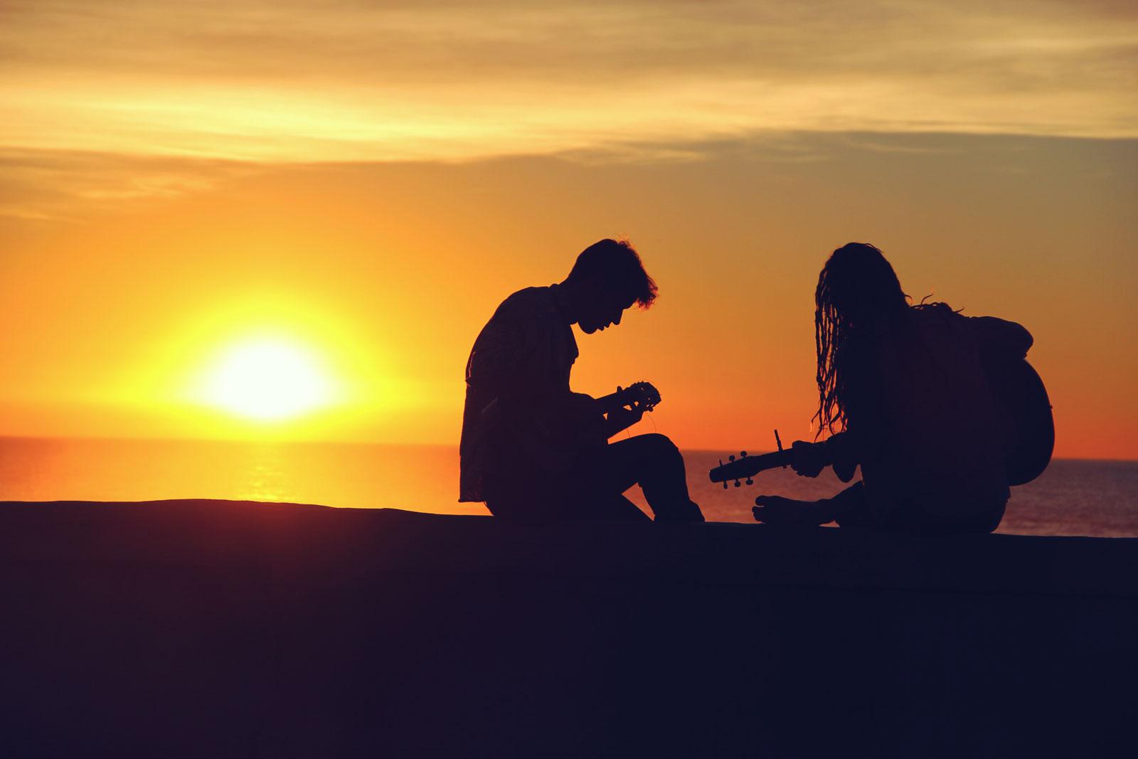 Playing Guitar Sunset