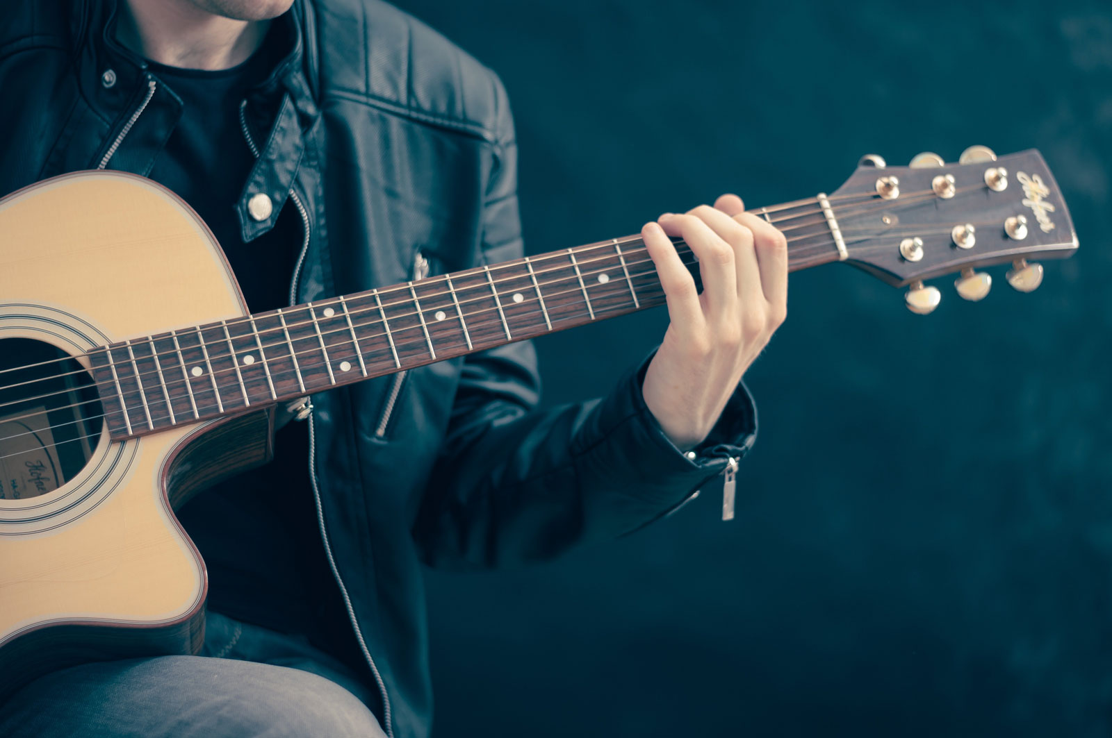 Man Playing Guitar | How To Find The Right Instructor For Guitar Lessons