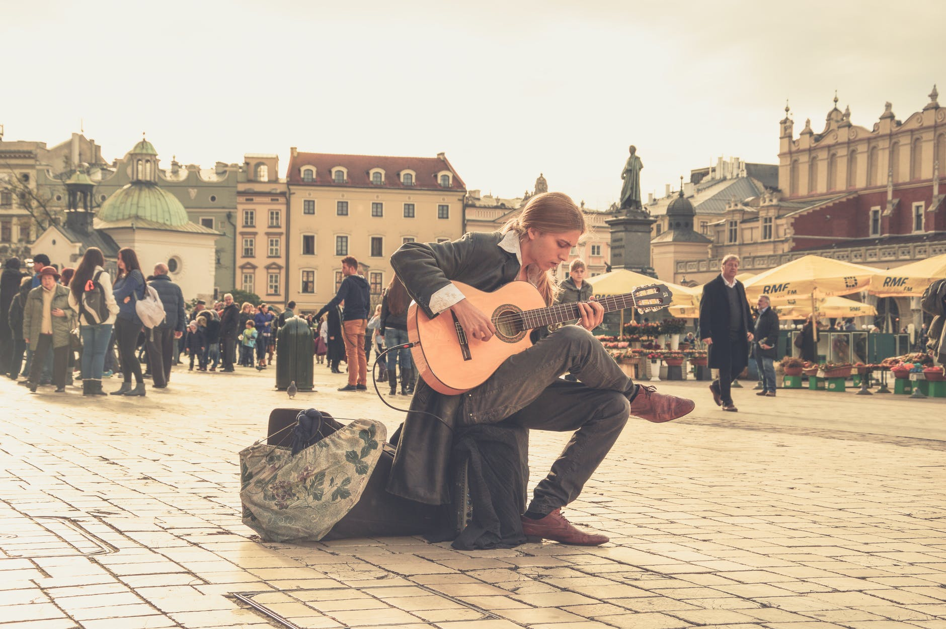 Man Playing Acoustic Guitar | The Top 15 Life Enhancing Benefits Of Learning Guitar
