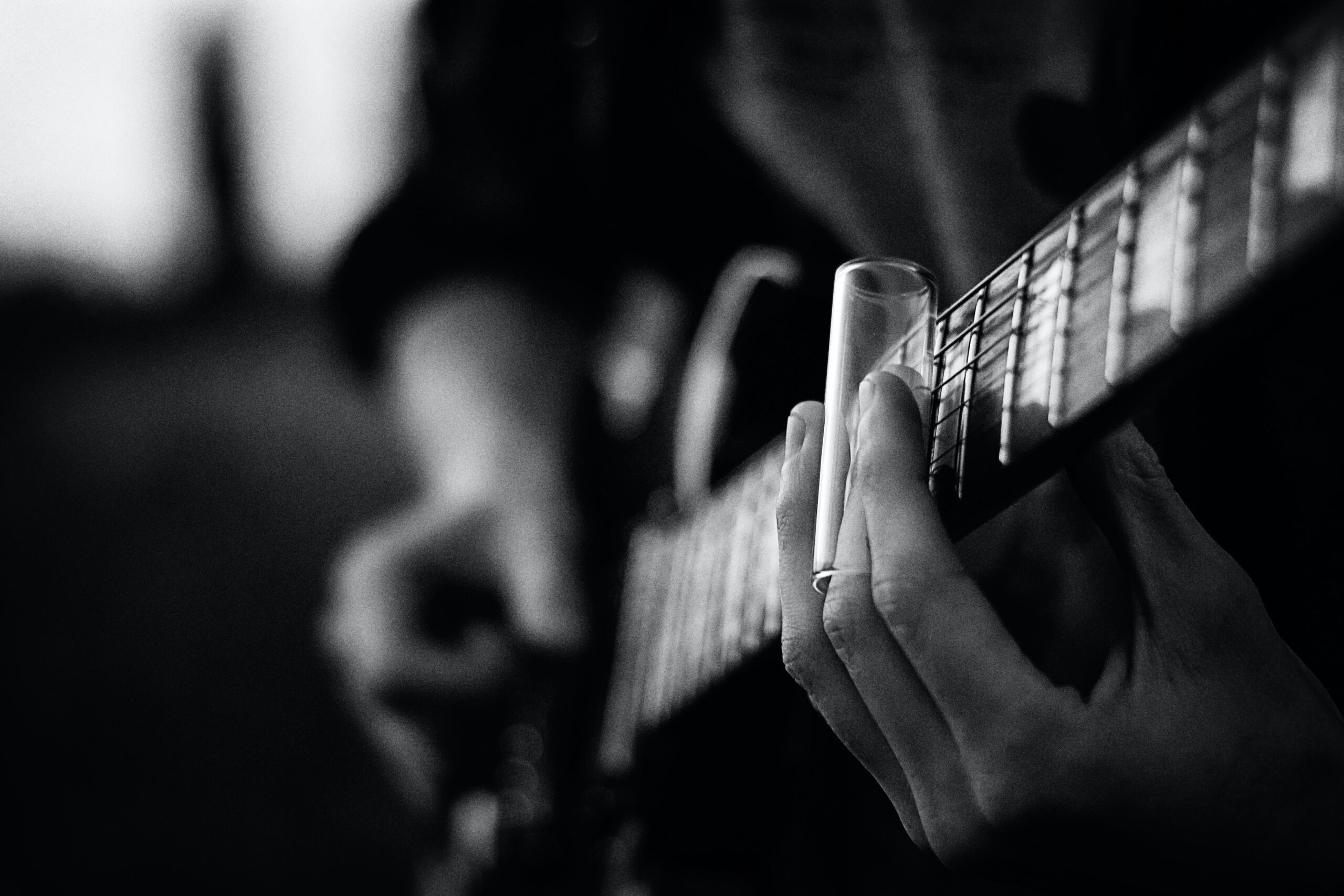 Person Playing A Guitar | 13 Easy to Find Guitar Accessories You Will Absolutely Benefit From