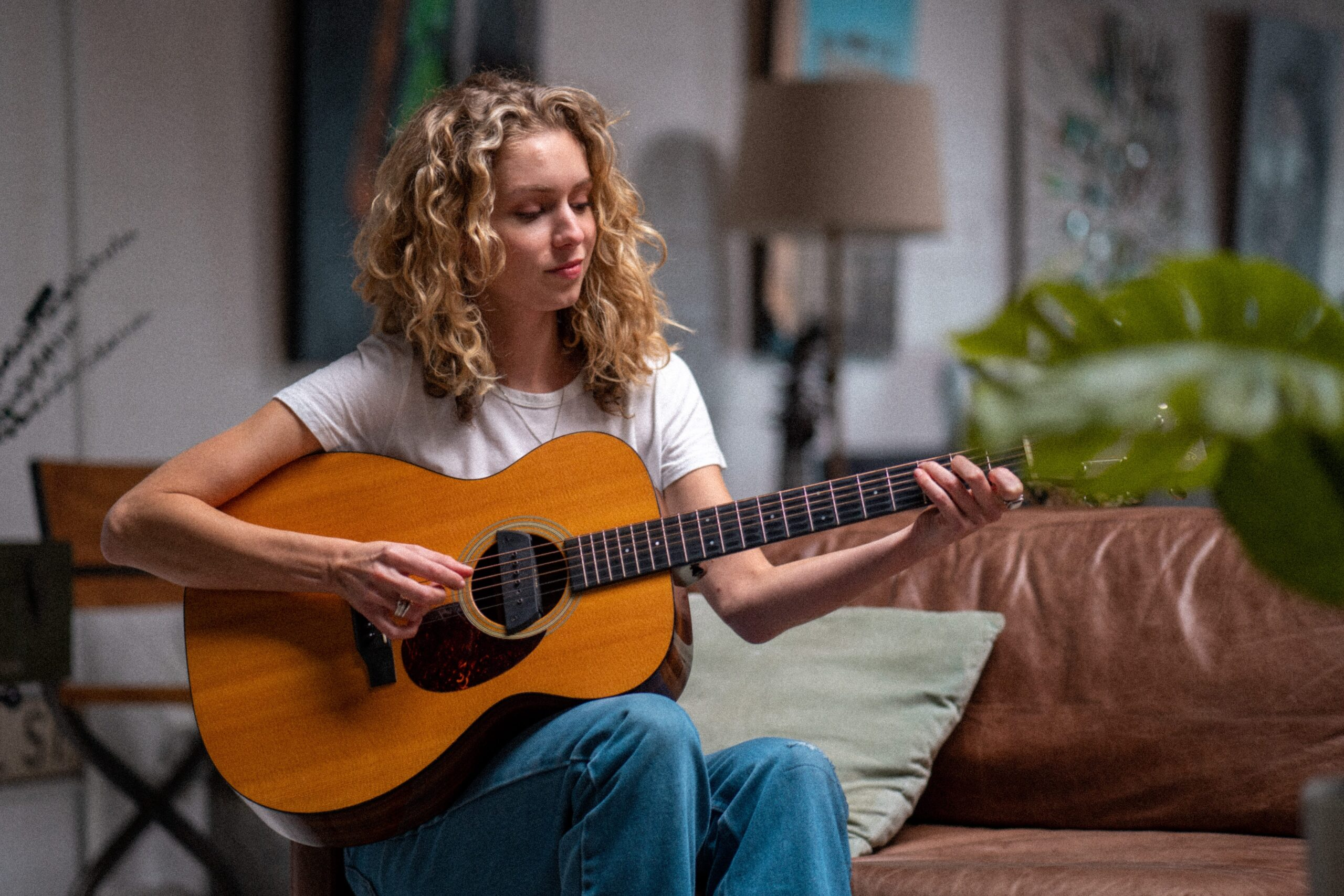 Woman Playing Guitar | The Top 15 Life Enhancing Benefits Of Learning Guitar