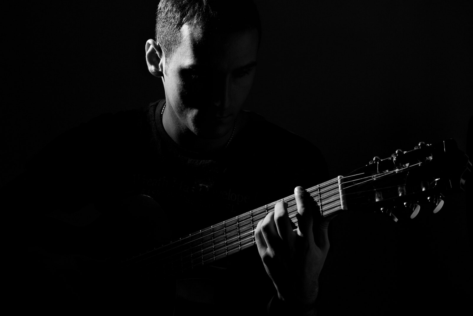 Man Playing Guitar | Learn Guitar With Apps: The 7 Best Ones To Use Today