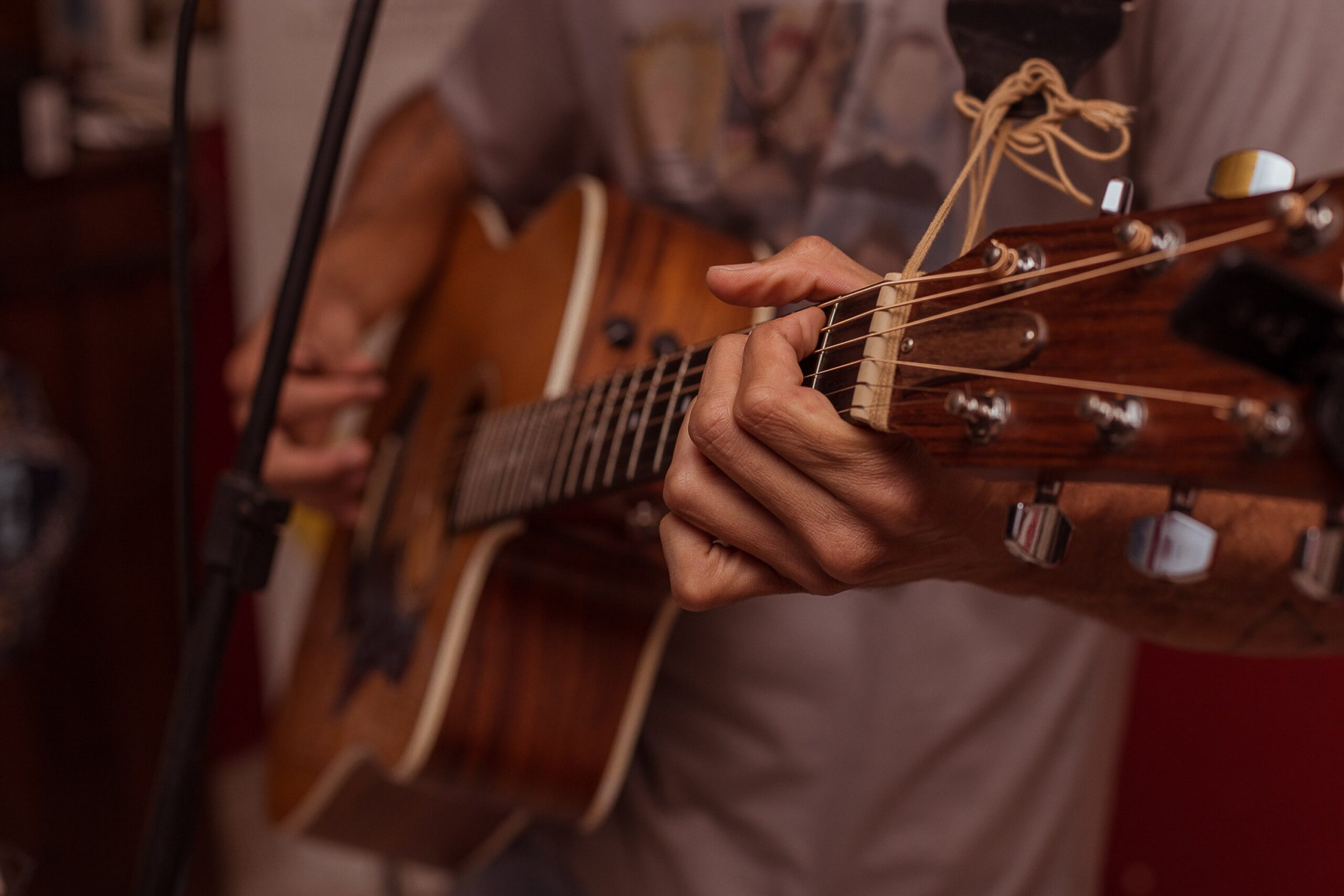 Brown Acoustic Guitar | 9 Proven Guitar Maintenance Tips You Can Easily Do Now