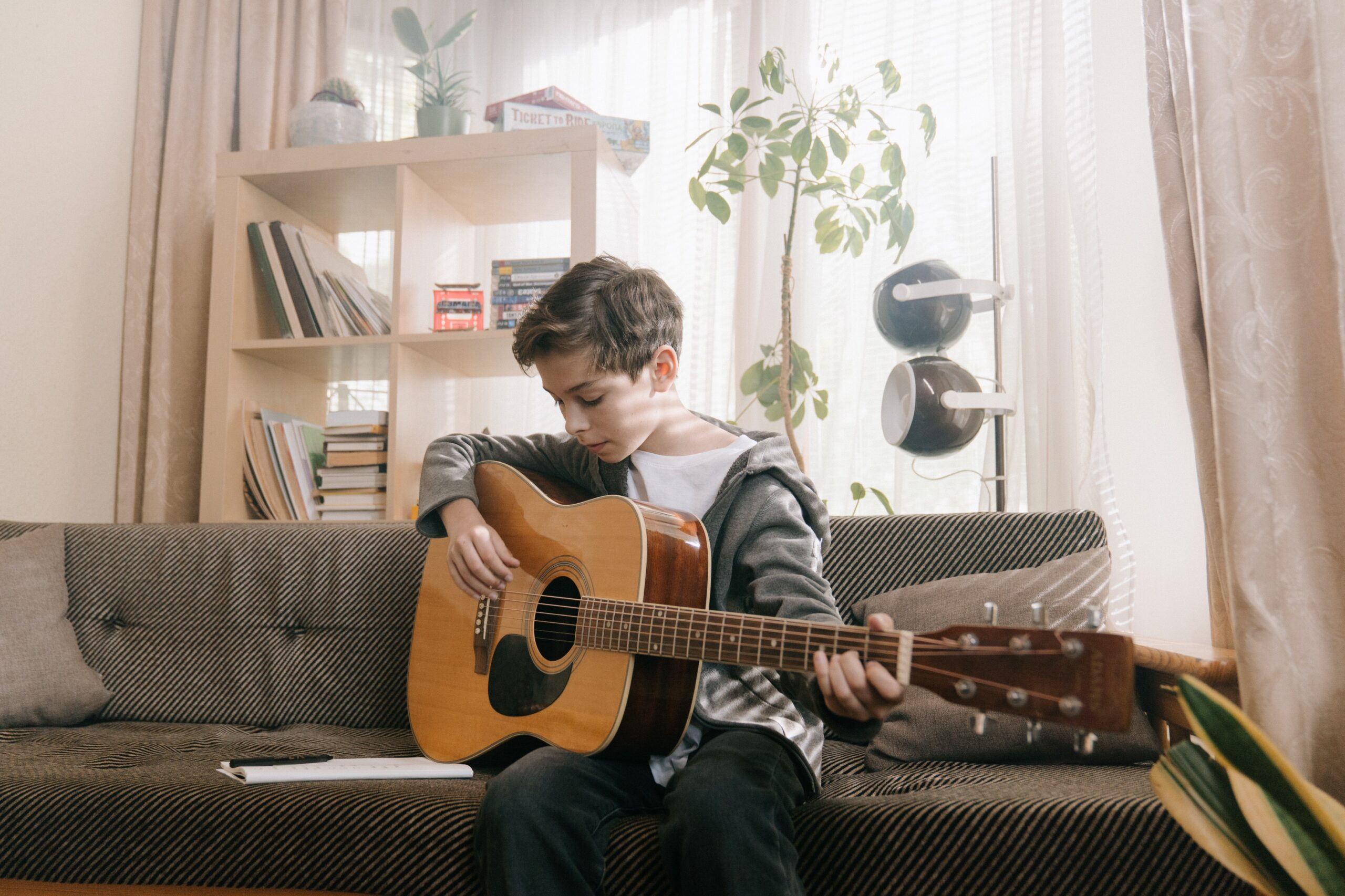Kid Playing Acoustic Guitar | 9 Attributes You Need To Have When Learning The Guitar