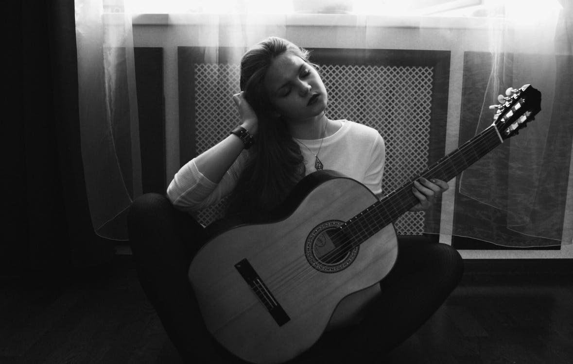 Girl Woman Playing Guitar | The Top 10 Life Benefits Of Learning Guitar