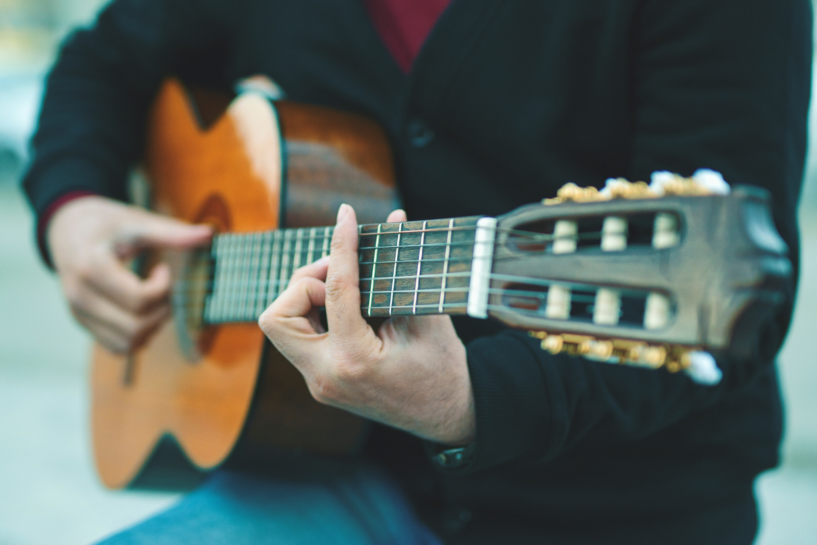 Man Playing Guitar | 6 Simple Steps to Teach Yourself Guitar Chords Today