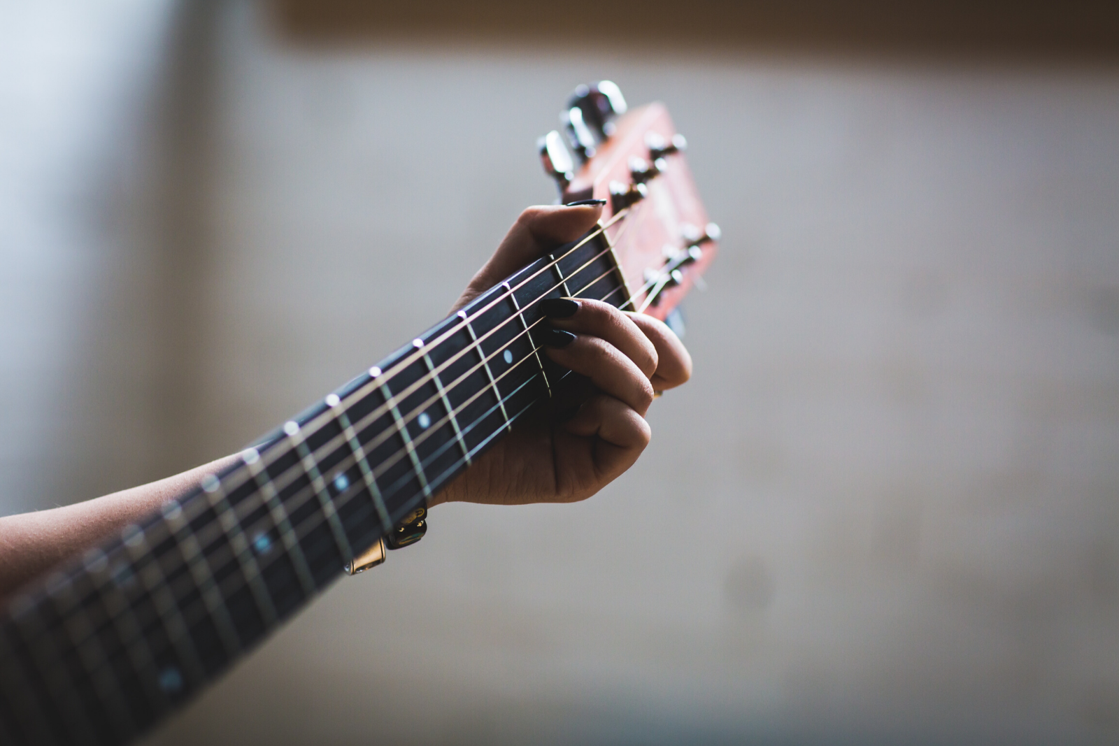 Man Playing Guitar | The Best Way To Learn Guitar On Your Own (6 Easy Tips)