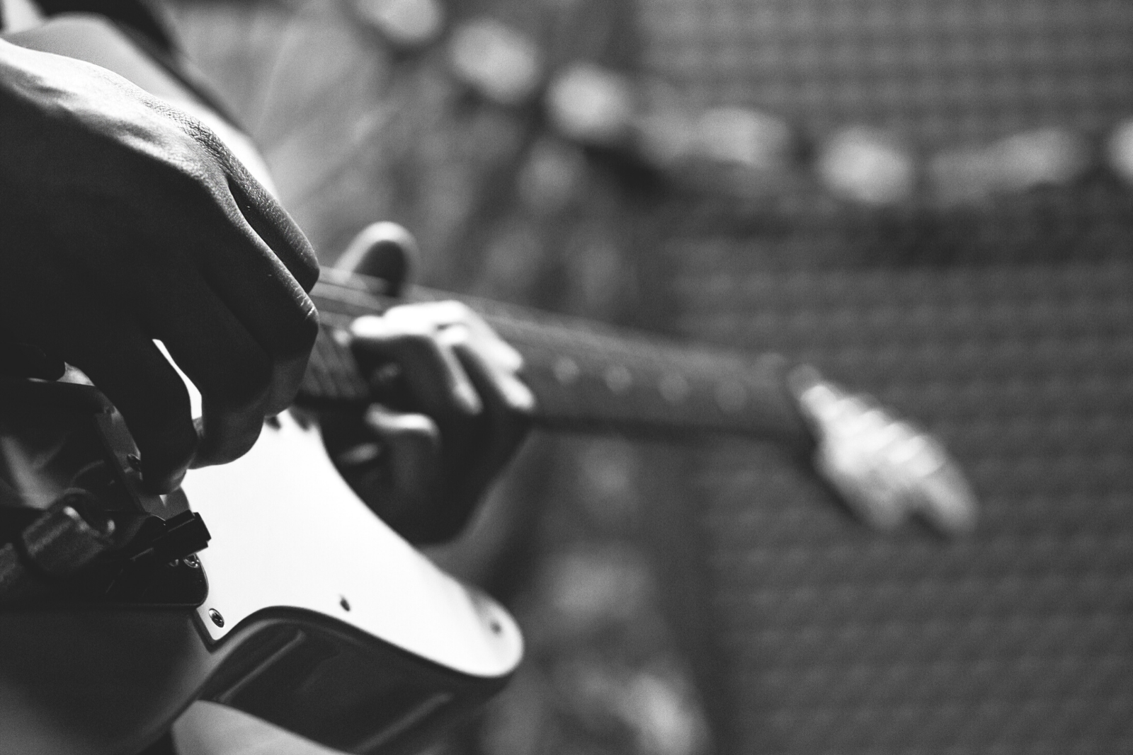 Man Playing Guitar | 6 Differences in Learning to Play Electric Guitar Vs Acoustic