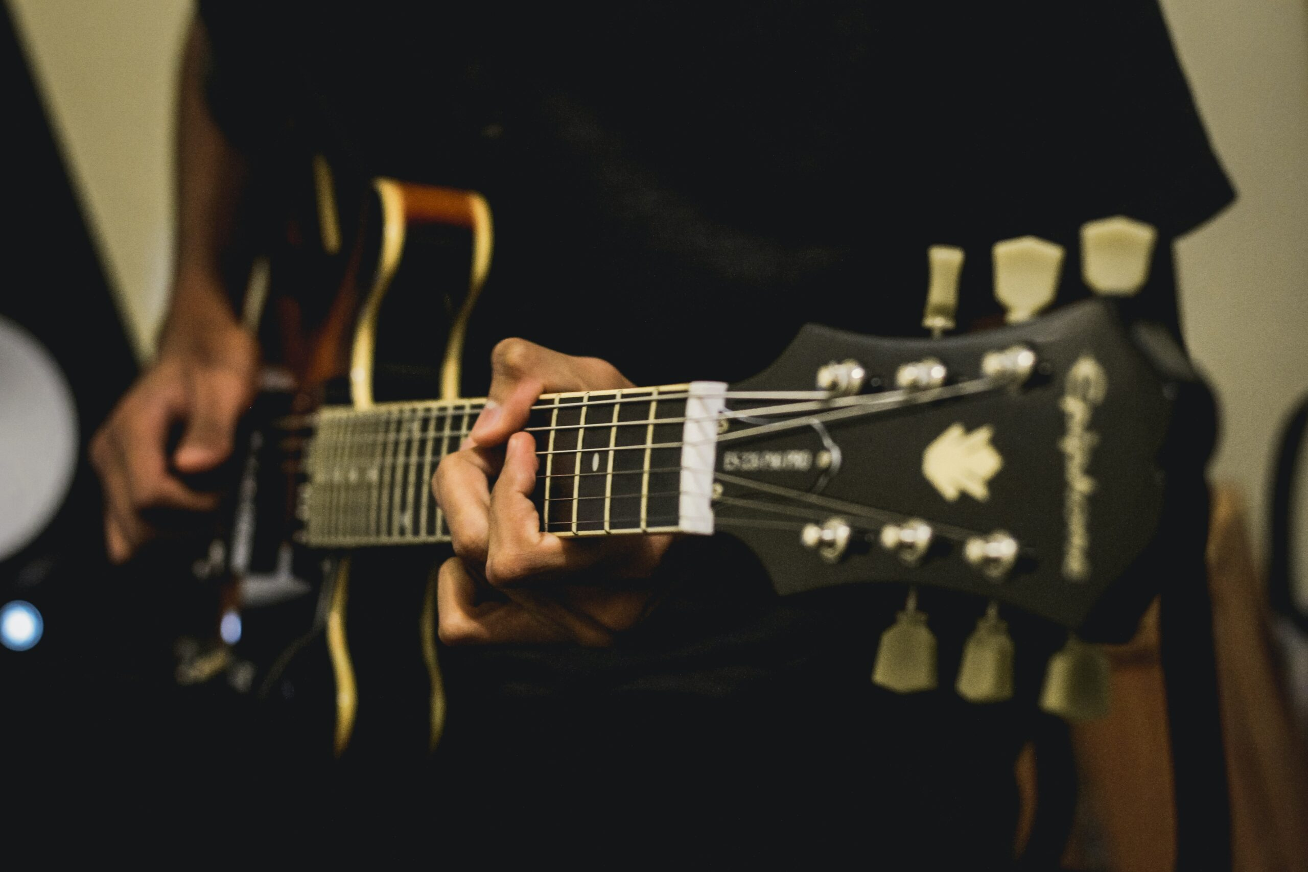 Person Playing Electric Guitar | 9 Simple Steps to Teach Yourself Guitar Chords Today