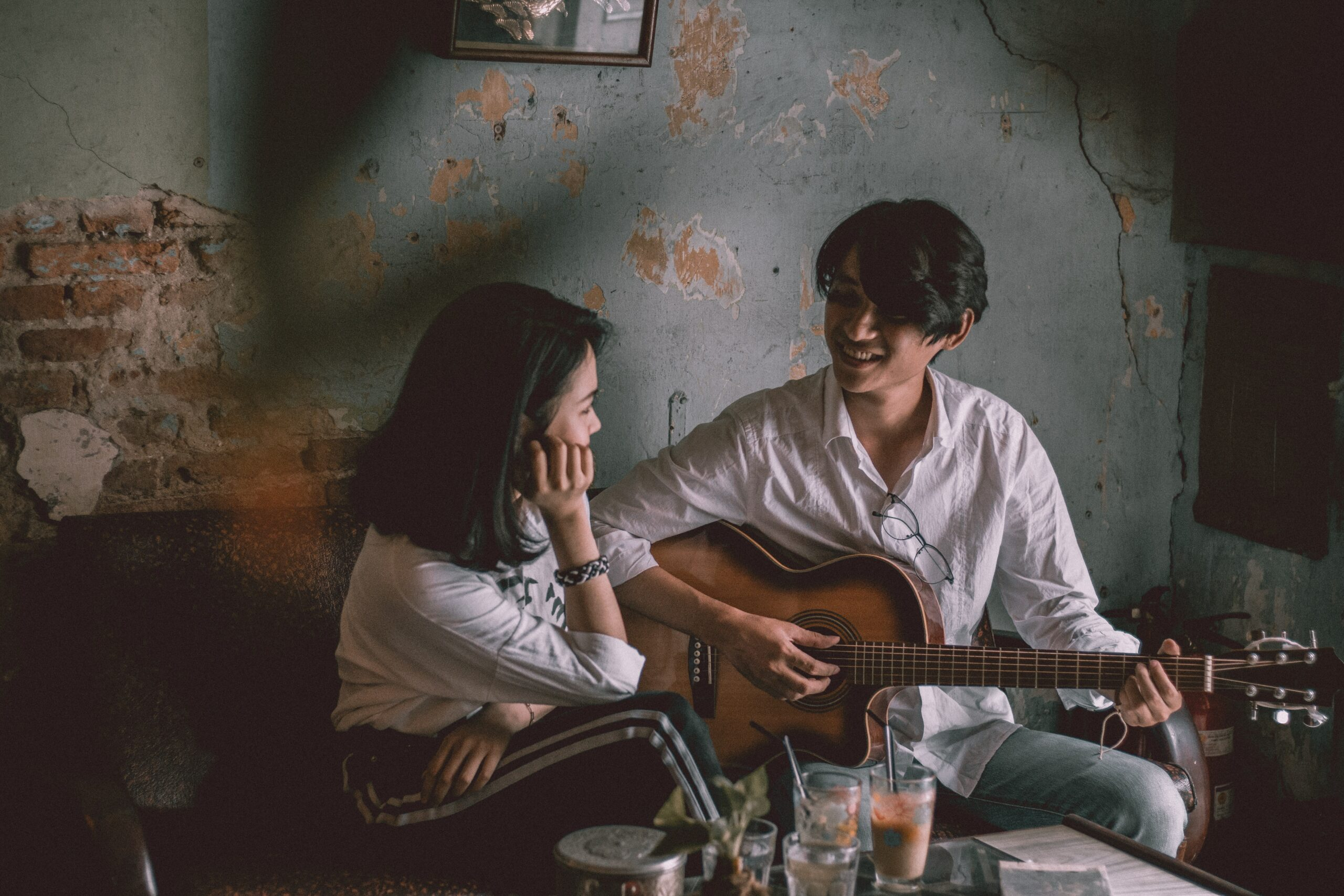 Man Playing Guitar with Girl   Best Way To Learn Guitar At Home Today (9+ Easy Tips)