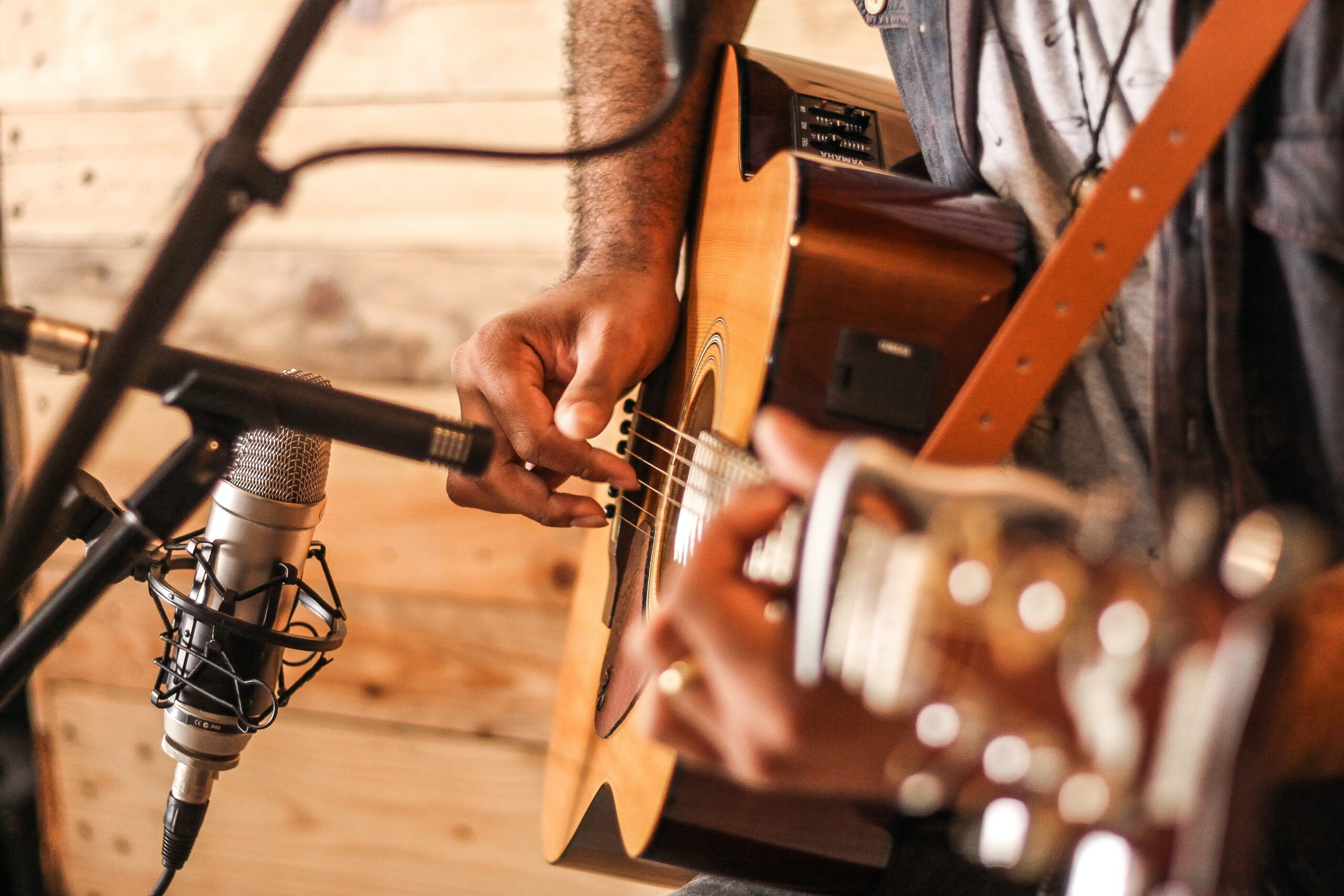 Person Playing Acoustic Guitar - How To Play Guitar For Beginners: A Step-by-Step Guide