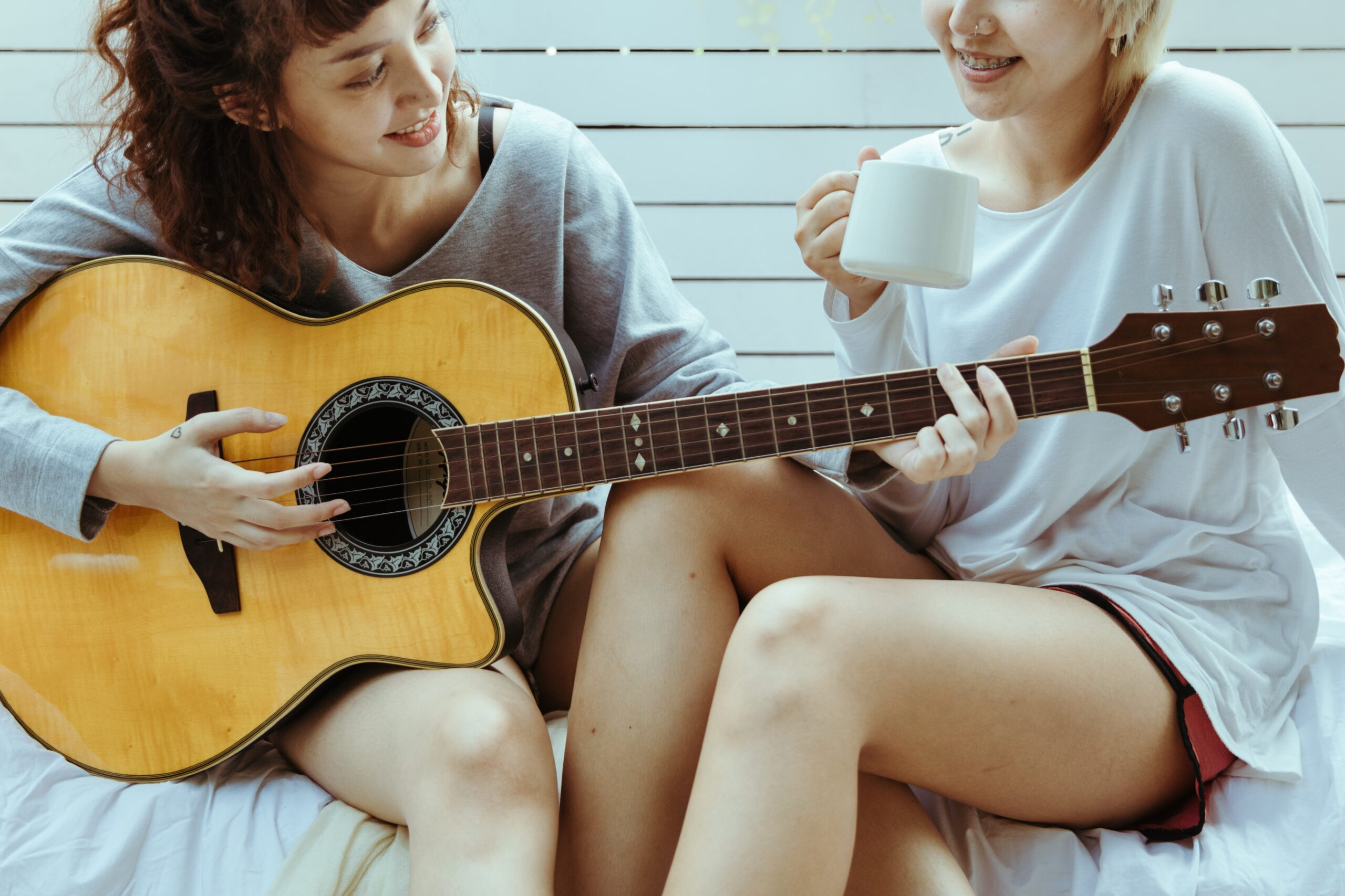 Two Girls Playing Guitar   Best Way To Learn Guitar At Home Today (9+ Easy Tips)