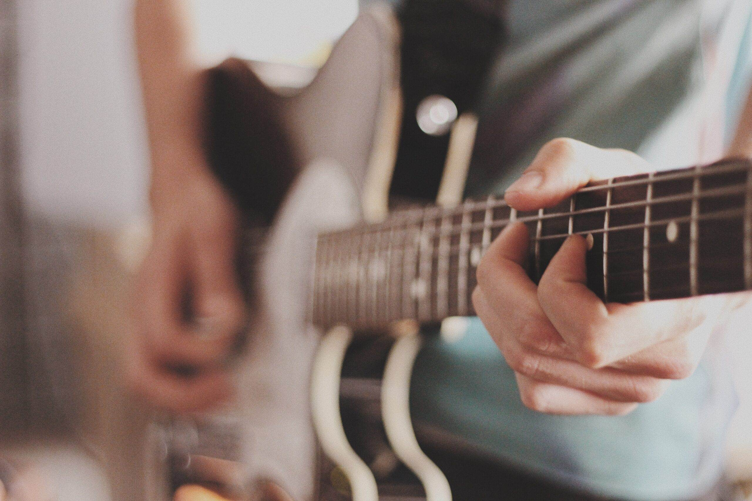 Person Playing Electric Guitar   Best Way To Learn Guitar At Home Today (11 Easy Tips)