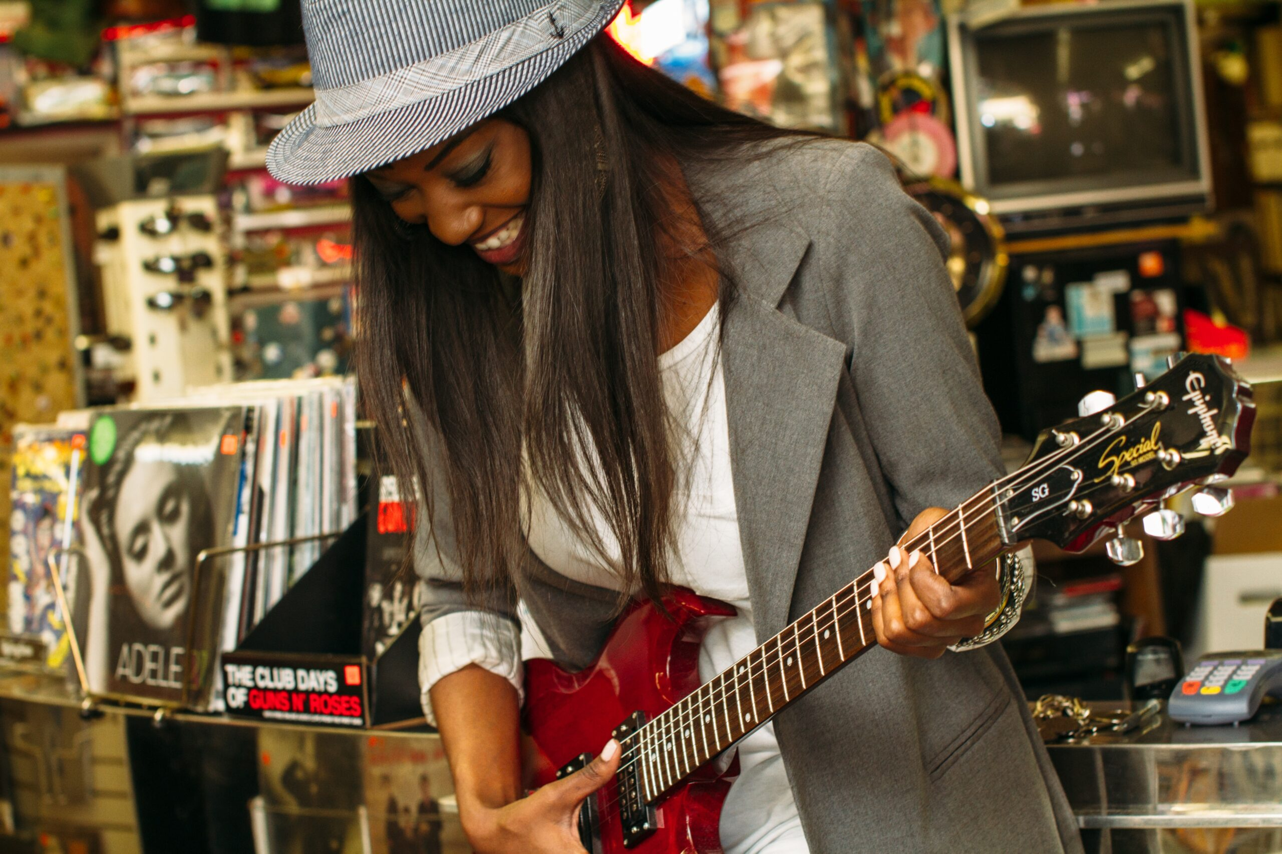 Woman Playing Telecaster Guitar | Top 10 Milestones To Shoot For When Learning To Play Guitar
