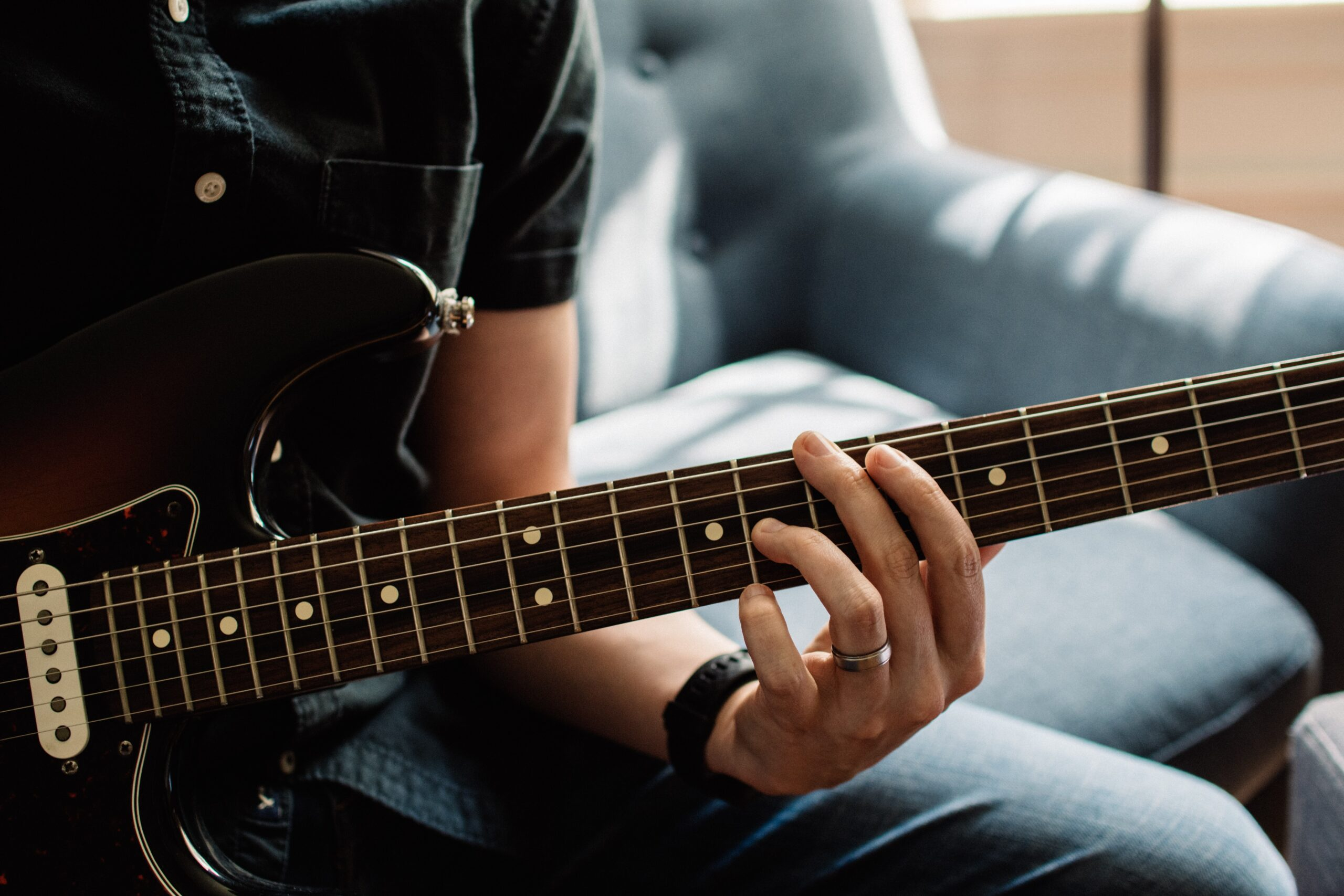 Person Playing Guitar   10 Proven Guitar Maintenance Tips You Can Easily Do Now